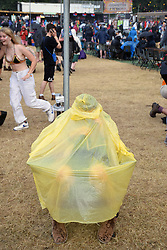 Latitude Festival, Henham Park, Suffolk, UK July 2019. Sheltering from the rain
