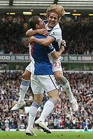 Football - Premier League - Blackburn Rovers vs. Manchester Utd<br /> Míchel Salgado celebrates going 1-0 up with goal scorer Brett Emerton of Blackburn Rovers at Ewood Park