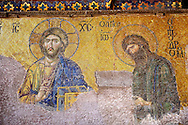 Byzantine Deësis ( Entreaty) mosaic , 1261, in which John The Baptist,  both shown in three-quarters profile, are imploring the intercession of Christ Pantocrator for humanity on Judgment Day.   Hagia Sophia, Istanbul, Turkey .<br /> <br /> If you prefer to buy from our ALAMY PHOTO LIBRARY  Collection visit : https://www.alamy.com/portfolio/paul-williams-funkystock/hagia-sophia-istanbul.html<br /> <br /> Visit our TURKEY PHOTO COLLECTIONS for more photos to download or buy as wall art prints https://funkystock.photoshelter.com/gallery-collection/3f-Pictures-of-Turkey-Turkey-Photos-Images-Fotos/C0000U.hJWkZxAbg