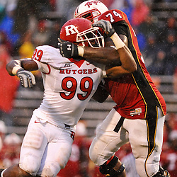 Sep 26, 2009; College Park, MD, USA; Rutgers defensive end Jonathan Freeny (99) is blocked by Maryland offensive lineman Bruce Campbell (74) during Rutgers' 34-13 victory over Maryland in NCAA college football at Byrd Stadium.