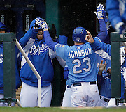 Kansas City Royals' Elliot Johnson (23) is congratulated after scoring off a Alex Gordon single in the third inning of a baseball game against the Tampa Bay Rays at Kauffman Stadium in Kansas City, Mo., Thursday, May 2, 2013.  (AP Photo/Colin E. Braley).