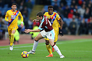 Wilfried Zaha of Crystal Palace (r)  looks to go past Jon Flanagan of Burnley. Premier League match, Burnley v Crystal Palace at Turf Moor in Burnley , Lancs on Saturday 5th November 2016.<br /> pic by Chris Stading, Andrew Orchard sports photography.