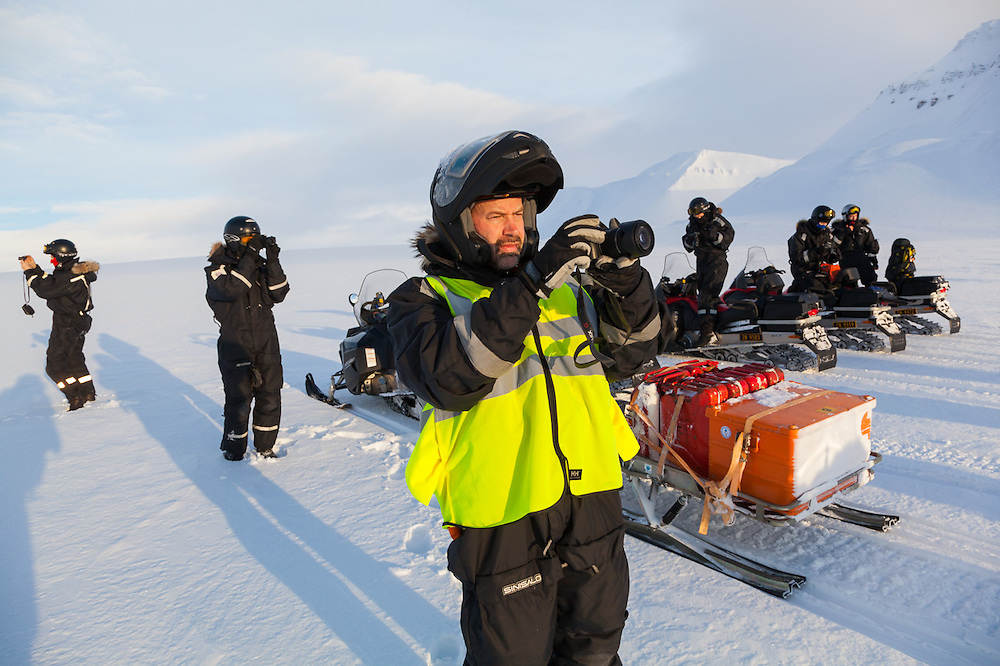 Glaciologist Nick Hulton and UNIS students take pictures on Rabotbreen, Svalbard on a class field trip by snowmobile to Tunabreen.