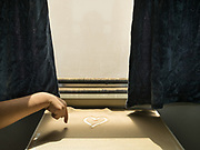 In a train, a boy draws a heart in the sand. On the train from Hotan to Kashgar.