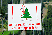 Forestation work, warning sign. Photographed in Austria