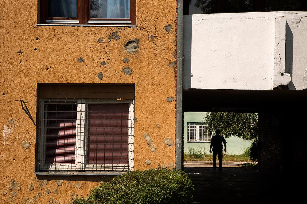 War damage on an apartment building in the Federation area of the Dobrinja neighborhood of Sarajevo, Bosnia and Hercegovina.