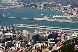 The airport the harbour of the Strait of Gibraltar. Photographs from the top of the Rock of Gibraltar. Images of Gibraltar, the British overseas territory located on the southern end of the Iberian Peninsula at the entrance of the Mediterranean.