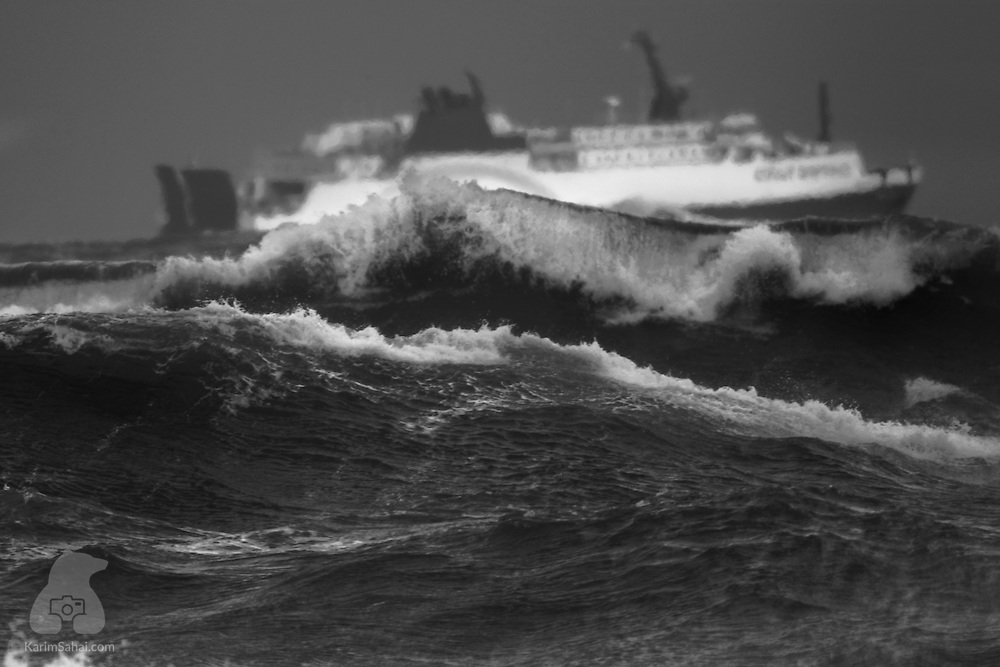 A ferry crosses Cook Strait during a storm, Wellington, New Zealand.