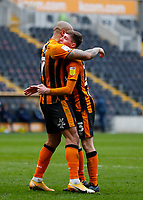 Hull City's Gavin Whyte is congratulated by Josh Magennis after he scores his side's second goal in the 60th minute to make it 2-0<br /> <br /> Photographer Lee Parker/CameraSport<br /> <br /> The EFL Sky Bet League One - Hull City v Bristol Rovers - Saturday 6th March 2021 - KCOM Stadium - Kingston upon Hull<br /> <br /> World Copyright © 2021 CameraSport. All rights reserved. 43 Linden Ave. Countesthorpe. Leicester. England. LE8 5PG - Tel: +44 (0) 116 277 4147 - admin@camerasport.com - www.camerasport.com