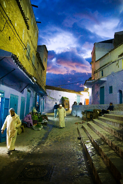Nighttime sets in over a busy pedestrian street in the Chefchaouen medina, Morocco, on October 28, 2007.
