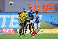 Carlisle United striker Jabo Ibehre wins a header during the Sky Bet League 2 match between Oxford United and Carlisle United at the Kassam Stadium, Oxford, England on 12 December 2015. Photo by Alan Franklin.