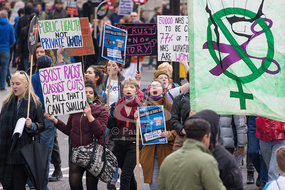 """London, April 16th 2016. Protesters chant anti-tory slogans as they march past St Martin In-the-Fields Church towards Trafalgar Square as thousands of people supported by trade unions and other rights organisations demonstrate against the policies of the Tory government, including austerity and perceived favouring of """"the rich"""" over """"the poor""""."""