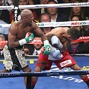 LAS VEGAS, NV - SEPTEMBER 13: Floyd Mayweather Jr. (L) catches Marcos Maidana with a left hook during their WBC/WBA welterweight title fight at the MGM Grand Garden Arena on September 13, 2014 in Las Vegas, Nevada. (Photo by Alex Menendez/Getty Images) *** Local Caption *** Floyd Mayweather Jr; Marcos Maidana