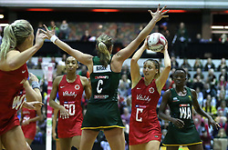 England Vitality Roses' Jade Clarke (right) and South Africa Spar Proteas Erin Burger (centre) battle for the ball during the Vitality Netball International Series match at The Copper Box, London.