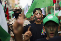 July 27, 2017 - Gaza City, The Gaza Strip, Palestine - Palestinian youths take part during a rally organized by the Hamas movement in Gaza City on July 27, 2017. Thousands of Muslims flocked to a major Jerusalem shrine Thursday for the first organized prayers at the site in nearly two weeks, following Israel's removal of security devices installed. (Credit Image: © Mahmoud Issa/Quds Net News via ZUMA Wire)