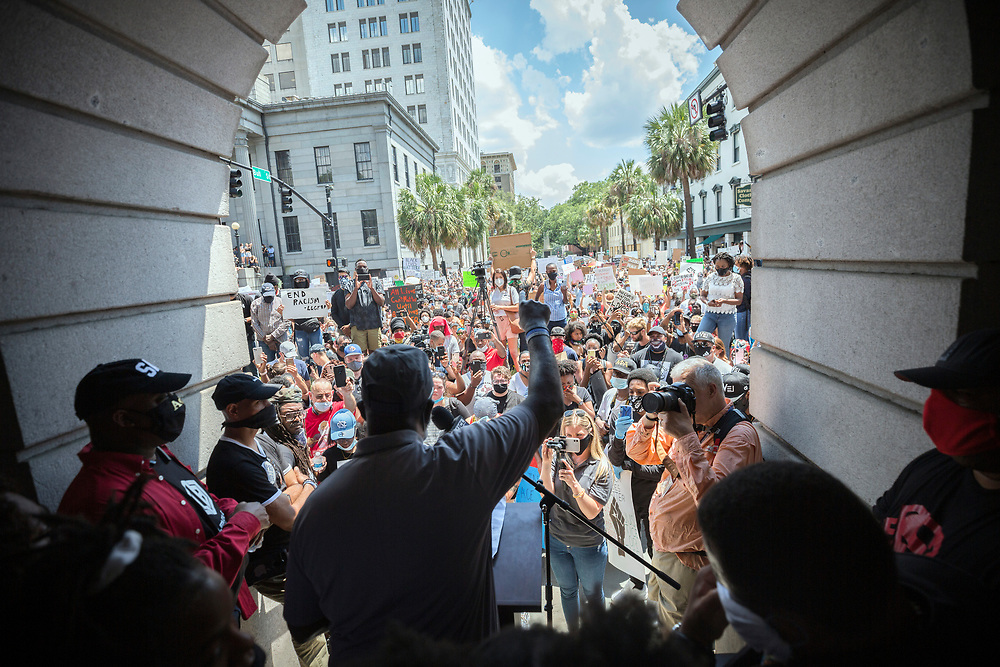 SAVANNAH, GA - MAY 31, 2020: A speaker addresses the gathering of protesters on the steps of City Hall during a rally, Saturday, May 31, 2020 in Savannah, Ga., The peaceful protest marched a short distance from Johnson Square to City Hall and then east on Bay Street before breaking into several smaller groups. (AJC Photo/Stephen B. Morton)