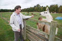 Man with learning disability on trip to farm with llama