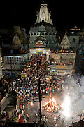 The evening before the festival of Holi, a bonfire is lit in front of the Jagdish Temple in Udaipur, Rajasthan, India.