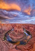 The Colorado River twists through Horseshoe Bend below Glen Canyon Dam near Page, Arizona