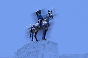 Digitally enhanced image of a statue of a man on a horse