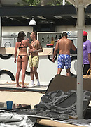 EXCLUSIVE - Justin Bieber flirts while wearing beach shorts and white socks in Dubai relaxes at a beach bar <br /> <br /> Justin Bieber relaxes in beach shorts and white tennis socks at the exclusive beach bar Zero Gravity Club before a concert in Dubai. He doesn't miss a chance though to flirt with the girls in bikinis. The young lady in a tiny bikini tanga appears to have received most of his attention. The pair talk excitedly while he shows off his tatoos and orders some drinks. <br /> ©HGM/Exclusivepix Media