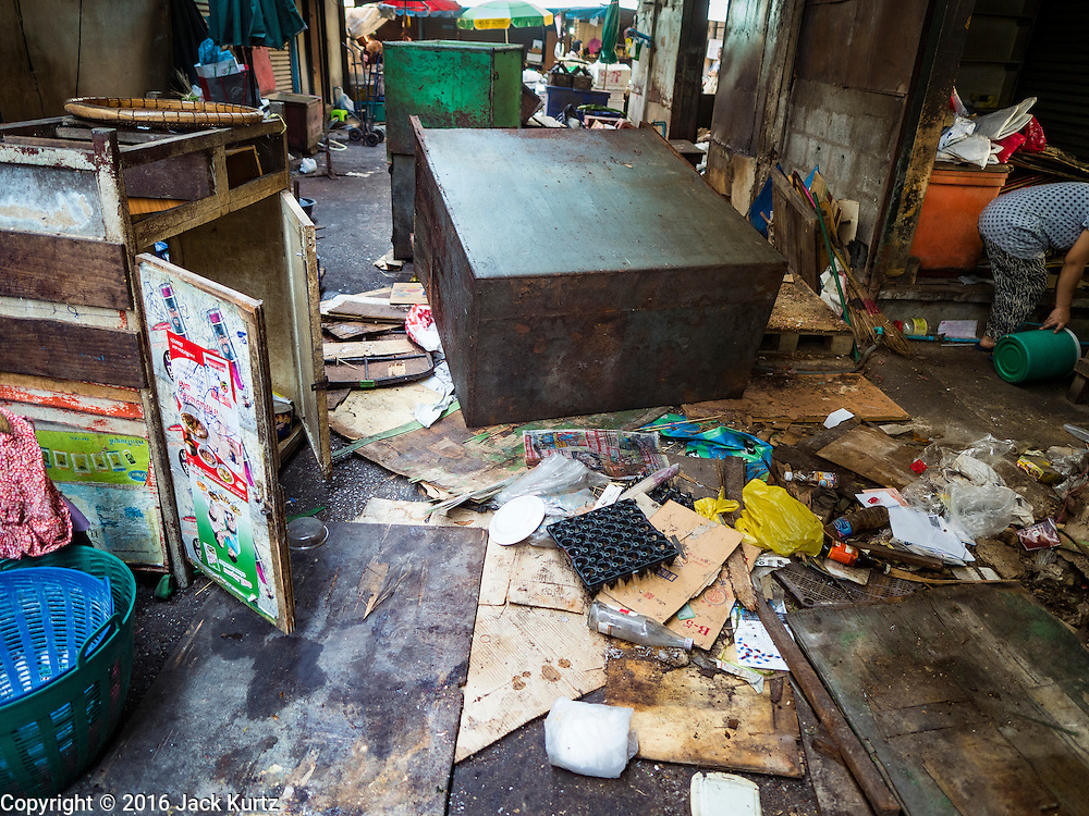 04 JANUARY 2016 - BANGKOK, THAILAND:       Trash left in the aisles of Bang Chak Market after the market closed. The market closed January 4, 2016. The Bang Chak Market serves the community around Sois 91-97 on Sukhumvit Road in the Bangkok suburbs. About half of the market has been torn down. Bangkok city authorities put up notices in late November that the market would be closed by January 1, 2016 and redevelopment would start shortly after that. Market vendors said condominiums are being built on the land.   PHOTO BY JACK KURTZ