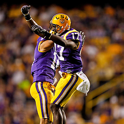 October 16, 2010; Baton Rouge, LA, USA; LSU Tigers cornerback Morris Claiborne (17) celebrates with cornerback Tyrann Mathieu (14) after an interception against the McNeese State Cowboys during a game at Tiger Stadium. LSU defeated McNeese State 32-10. Mandatory Credit: Derick E. Hingle