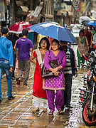 06 AUGUST 2015 - KATHMANDU, NEPAL: People walk down Sukra Path during a monsoon rain. It is a popular shopping street in Kathmandu.      PHOTO BY JACK KURTZ