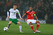 Ashley Williams of Wales ® looks to go past Steven Davis of Northern Ireland. Wales v Northern Ireland, International football friendly match at the Cardiff City Stadium in Cardiff, South Wales on Thursday 24th March 2016. The teams are preparing for this summer's Euro 2016 tournament.     pic by  Andrew Orchard, Andrew Orchard sports photography.