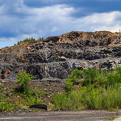 Mahanoy City, PA - June 22, 2016:   Mounds of chum, scrap materials because of size or impurities, sorted from processed anthracite, near  a coal breaker.