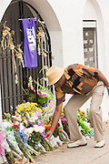 A family member of the Charleston Nine places flowers outside the Mother Emanuel African Methodist Episcopal Church following a memorial service for the Charleston Nine on the anniversary of the mass shooting June 18, 2016 in Charleston, South Carolina. Nine members of the church community were gunned down during bible study inside the church on June 17, 2015.
