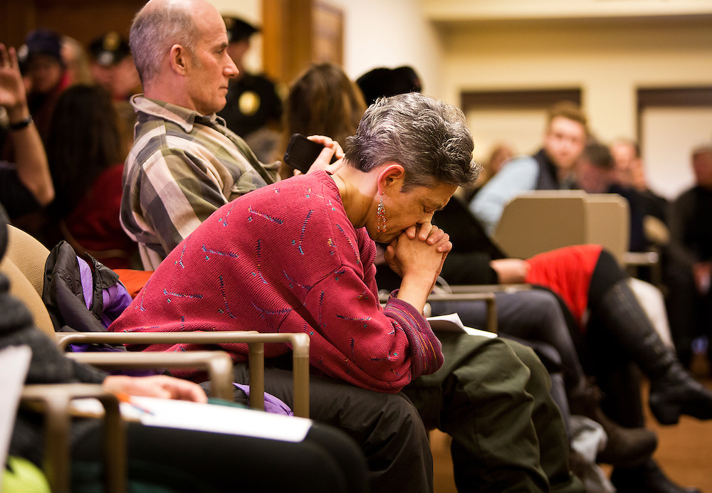 MADISON, WI – DECEMBER 19: A woman bows her head in prayer as the Wisconsin Electoral College meets to cast their ballots at the Wisconsin State Capitol on Monday, December 19, 2016.