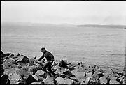 "9707-K198. written on original negative: ""Beating it. CLA"" man running from seal. St. Pauls Island. Pribilof Group. July 11, 1919"