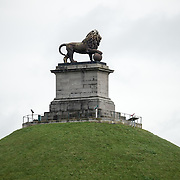 The statue on top of the Lion's Mound (Butte du Lion), an artificial hill built on the battlefield of Waterloo to commemorate the location where William II of the Netherlands was injured during the battle. The hill is situated on a spot along the line where the Allied army under the Duke of Wellington's command took up positions during the Battle of Waterloo.