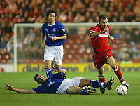 Photo. Andrew Unwin.<br /> Middlesbrough v Everton, Carling Cup Fourth Round, Riverside Stadium, Middlesbrough 03/12/2003.<br /> Middlesbrough's Szilard Nemeth (r) goes past the sliding challenge of Everton's David Unsworth (l).