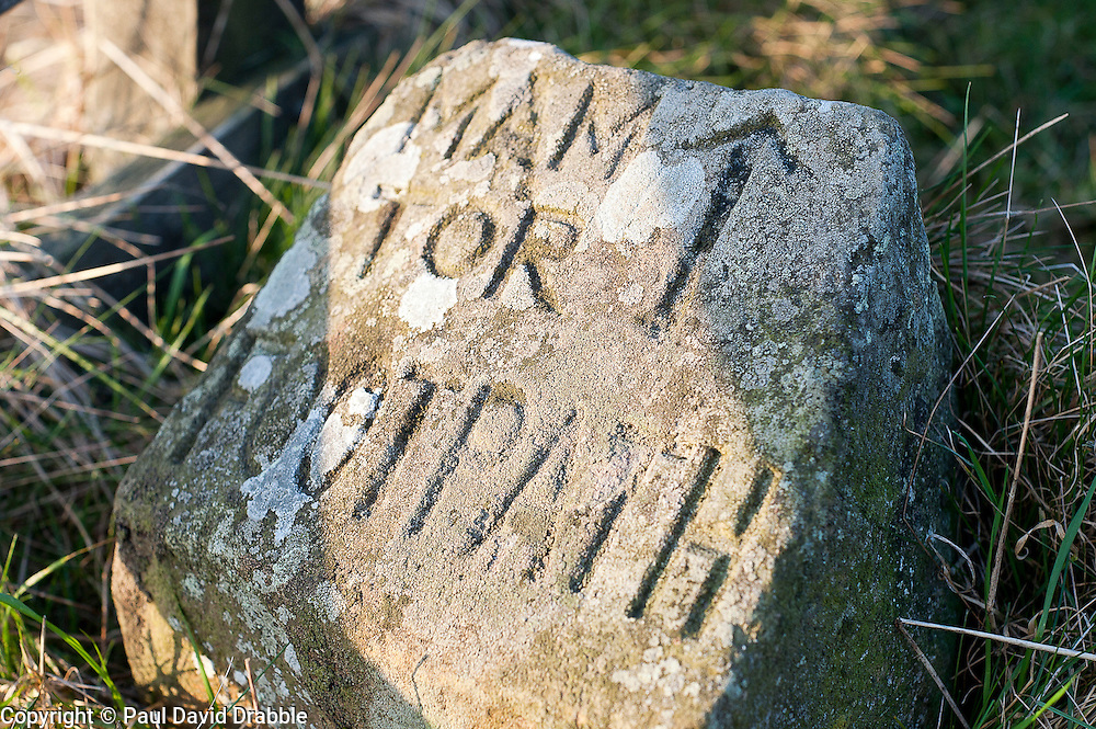 Stone Footpath Marker on Mam Tor also known as Mother Hill or shivering Mountain near Castleton in the High Peak of Derbyshire, England..www.pauldaviddrabble.co.uk.15 January 2012.Image © Paul David Drabble