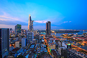 HO CHI MINH CITY, VIETNAM - JUNE 9, 2015 : Saigon sunset evening view on high at downtown center with buildings across riverside Saigon river Ho Chi Minh City