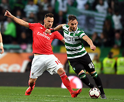 LISBON, Feb. 4, 2019  Haris Seferovic (L) of Benfica vies with Nemanja Gudelj of Sporting during the Portuguese League soccer match between SL Benfica and Sporting CP in Lisbon, Portugal, Feb. 3, 2019. Benfica won 4-2. (Credit Image: © Xinhua via ZUMA Wire)