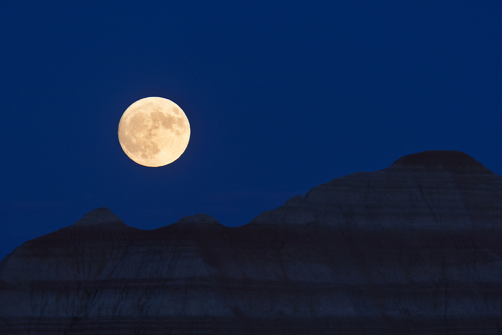 A supermoon rises over the badlands of South Dakota on the night of November 13, 2016. This supermoon is the closest and brightest that it has been to the earth since 1948.