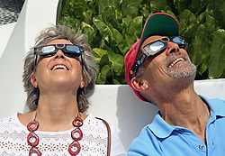 Lynn Capaldo and Jonathan Katzen watch the solar eclipse at the Frost Museum on Monday, Aug. 21, 2017 in downtown Miami, Fla. Photo by C.M. Guerrero/Miami Herald/TNS/ABACAPRESS.COM