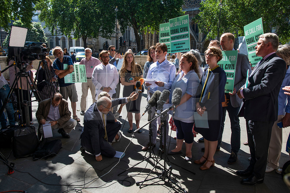 """© Licensed to London News Pictures. 27/06/2018. London, UK. Rebecca Steinfeld and Charles Keidan, who have """"deep-rooted"""" ideological objections to the institution of marriage, speak to the press after Supreme Court judges ruled in their favour in their legal battle to grant heterosexual couples the right to enter into civil partnership. Photo credit: Rob Pinney/LNP"""