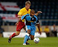 Photo: Richard Lane.<br />Wycombe Wanderers v Watford. Pre Season Friendly. 26/07/2006. <br />Watford's Matt Bloofield breaks from Watford's Jey Demerit.