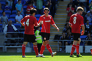 Cardiff city's Peter Whittingham © celebrates with Kim Bo-Kyung after he scores the 1st goal. Pre season friendly match, Cardiff city v Athletic Club Bilbao at the Cardiff city stadium in Cardiff,  South Wales on Saturday 10th August 2013. pic by Andrew Orchard,  Andrew Orchard sports photography,