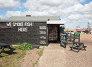 Fish shack specialising in smoked fish on the beach at Aldeburgh, Suffolk, England