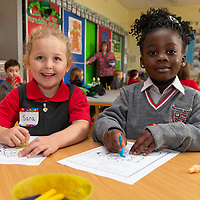Sara Donnelly and Felicity Yeboah enjoy colouring on their First day at Ennis National School