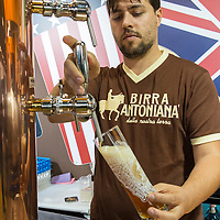A man pour some Birra Antoniana from Padova at Biennale del Gusto on October 28, 2013 in Venice, Italy. The Biennale del Gusto is an exhibition held over four days, dedicated to traditional food and drinks from all regions of Italy.
