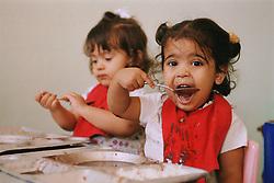 Nursery school children eating,
