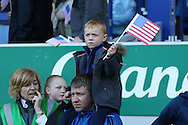 a young Everton fan waves an Aamerican flag for Everton Goalkeeper Tim Howard's last game. Barclays Premier League match, Everton v Norwich City at Goodison Park in Liverpool on Sunday 15th May 2016.<br /> pic by Chris Stading, Andrew Orchard sports photography.