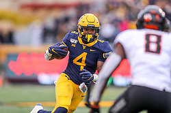 Nov 23, 2019; Morgantown, WV, USA; West Virginia Mountaineers running back Leddie Brown (4) runs the ball during the third quarter against the Oklahoma State Cowboys at Mountaineer Field at Milan Puskar Stadium. Mandatory Credit: Ben Queen-USA TODAY Sports