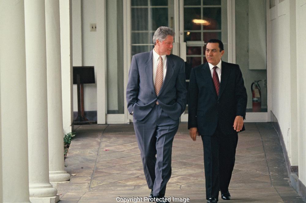 Washington DC 1993/04/06 President William J. Clinton Walking with Egyptian President Hosni Mubarak along the White<br />Photo by Dennis Brack